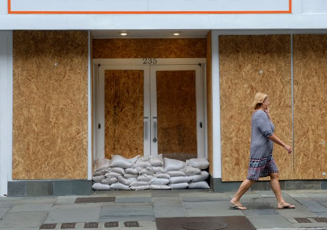 Mostly deserted, much of downtown Charleston, S.C. is boarded up and closed on Thursday, Sept. 13, 2018 in advance of Hurricane Florence. (Matthew Fortner/The Post And Courier via AP)