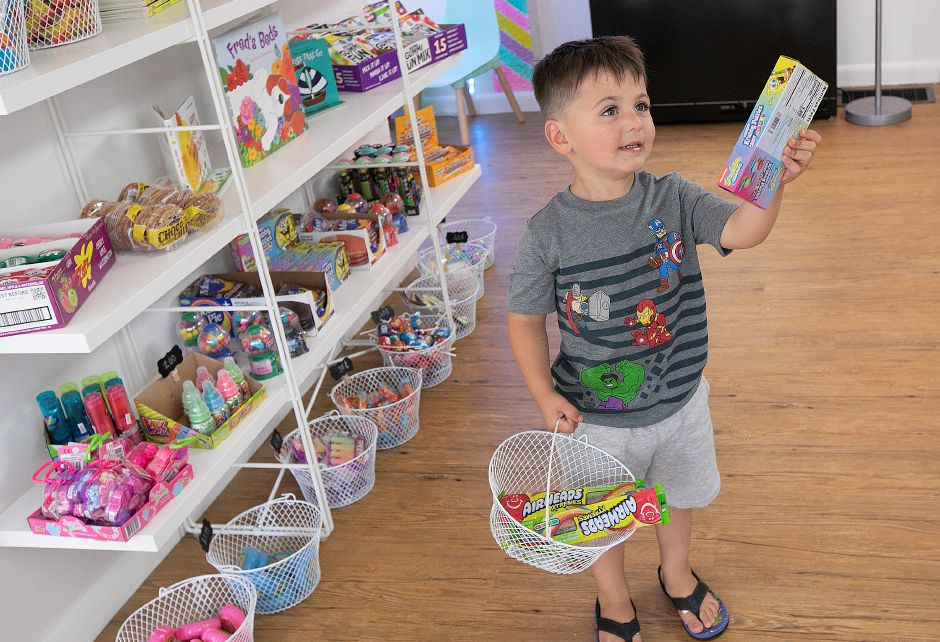 Joey Calvanese, 3, of Southington, adds a box of Gummy Krabby Patties to his basket at Frootie Tooties Candy & More, 88 Center St., Southington, Wed., June 5, 2019. Dave Zajac, Record-Journal