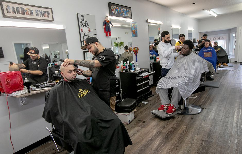 Barber David Ortiz, left, owner of Classic Cutz, gives a straight razor shave to longtime customer, Larry Velez, of Hamden, at the new shop at 35 N. Colony Rd. in Wallingford, Fri. Feb. 8, 2019. Dave Zajac, Record-Journal