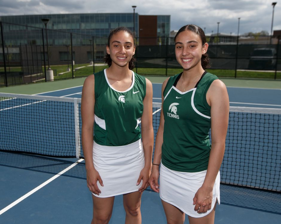 Abby Lespier, left, and her twin sister, Haley, took up tennis this spring as freshmen and quickly emerged as Maloney's No. 1 doubles team. They qualified for the State Open and helped the Spartans reach the Class M state tournament.