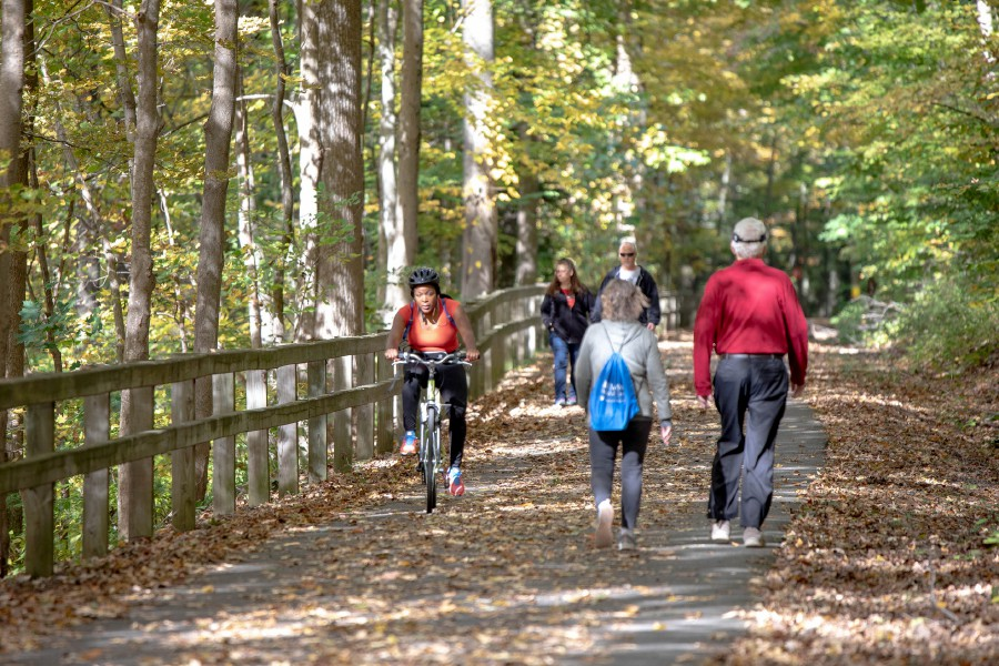 Walkers and bikers enjoy the fall foliage along the Quinnipiac River Linear Trail in Meriden on Oct. 13, 2019. | Devin Leith-Yessian/Record-Journal