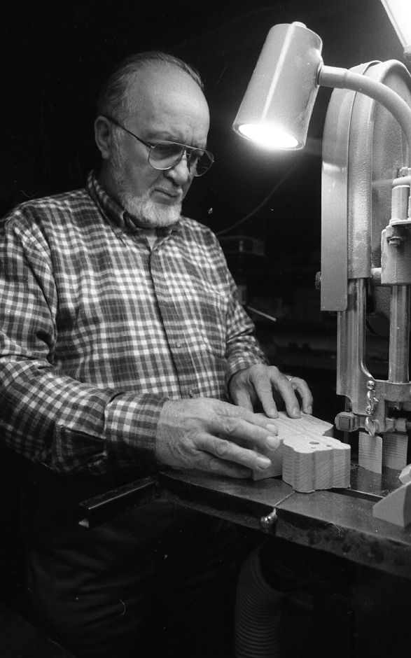 RJ file photo - Warren H. Becker begins cutting one of the many wooden toys he and his wife make in their Wallingford home, April 1989.