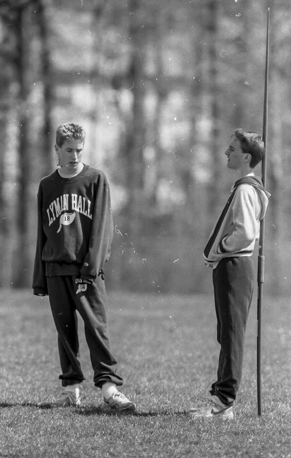 RJ file photo - Lyman Hall High School track team members Matt Tyler, 16, and Brian Appell, 16, wait their turn to compete in an event April 20, 1989. The team was scheduled to host a meet against North Branford, but the visitors never showed up.
