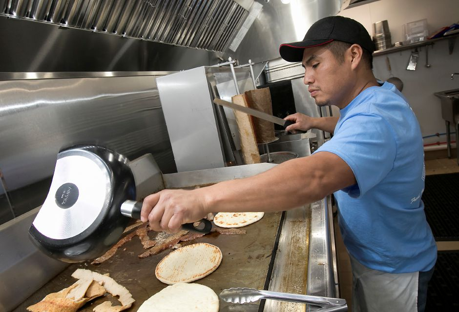 Guadalupe Xelhua, co-owner, grills chicken, beef and lamb for gyros at Crazy Greek, a new restaurant at 1143 Meriden-Waterbury Tpke. in Southington, Thursday, February 23, 2017. | Dave Zajac, Record-Journal