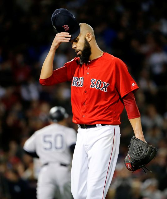 Boston Red Sox starting pitcher David Price reacts after giving up a home run to New York Yankees