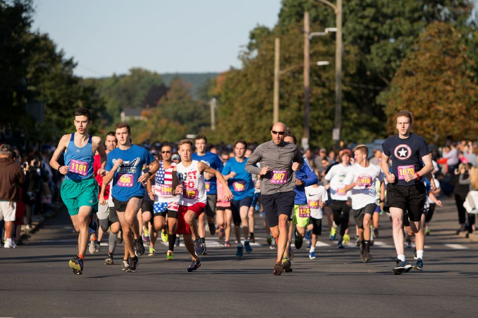 Runners leave the start in the 5K Sunday during the Apple Harvest Southington YMCA 5K and 5 mile road race in Southington September 30, 2018 | Justin Weekes / Special to the Record-Journal