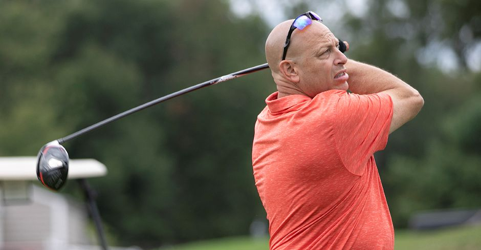 Gary Banack, of Meriden, belts a drive on Hole #1 during the annual Hunter