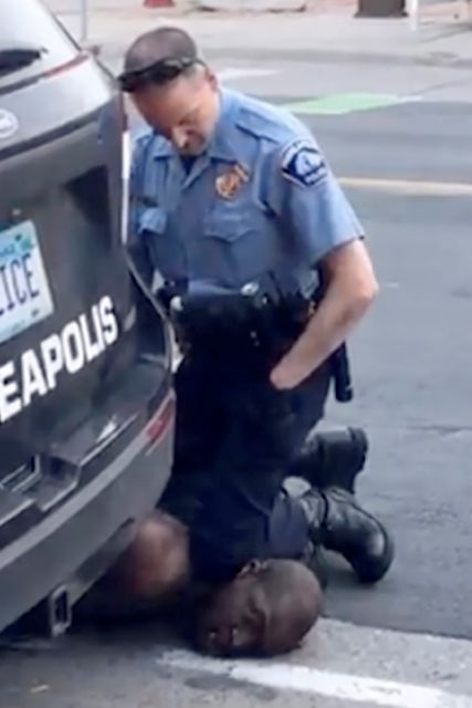 In this Monday, May 25, 2020, frame from video provided by Darnella Frazier, a Minneapolis officer kneels on the neck of a handcuffed man who was pleading that he could not breathe in Minneapolis. Four Minneapolis officers involved in the arrest of a George Floyd who died in police custody were fired Tuesday. (Darnella Frazier via AP)