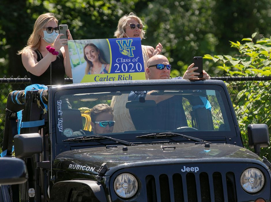 Family members take photos and video of graduate Carley Rich from their vehicle during graduation ceremonies at H.C. Wilcox Technical High School in Meriden, Mon., Jun. 22, 2020. Dave Zajac, Record-Journal