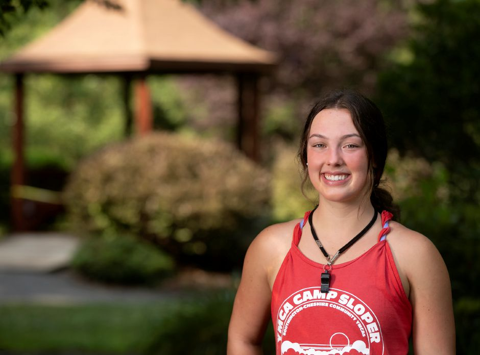 Sarah Meade, 18, valedictorian of Southington High School's class of 2020, smiles in the Memorial Garden at Camp Sloper in Southington on Thursday. Meade is a lifeguard at the camp. Meade will be heading to the University of Connecticut to study business or law. Dave Zajac, Record-Journal