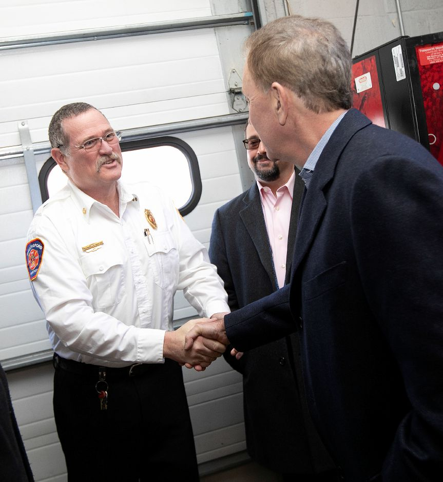Gov. Ned Lamont, right, greets Fire Chief Richard Heidgerd during a visit to Wallingford, Thurs., Feb. 28 2019. Dave Zajac, Record-Journal