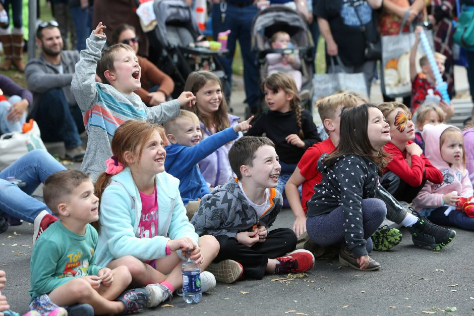 A crowd of children laugh and interact with The Amazing Andy during his magic act on the main stage at the annual Apple Harvest Festival in Southington on Saturday, Oct. 12, 2019. Emily J. Tilley, special to the Record-Journal.