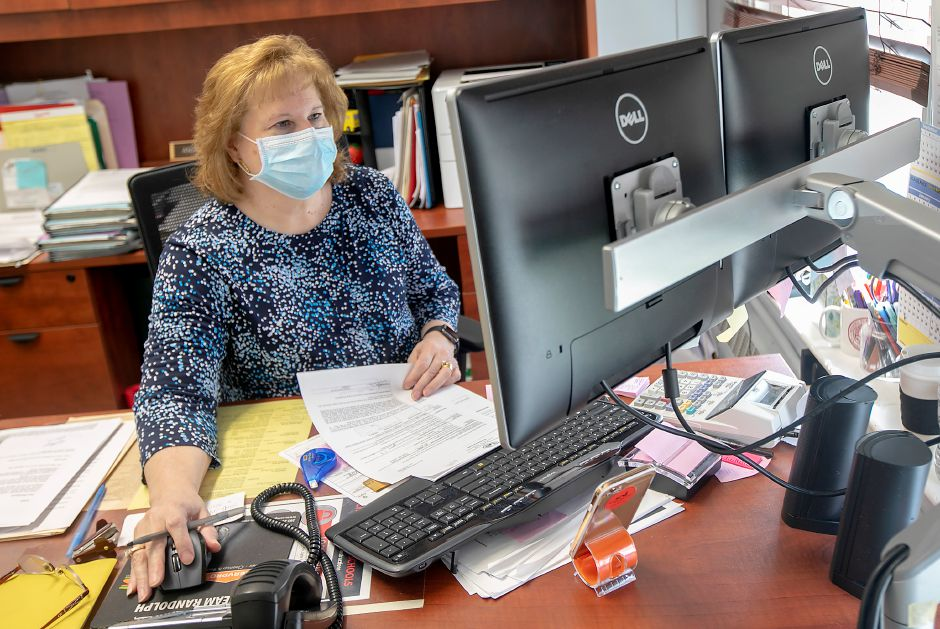 Human Resources Manager Angela Lach works at her desk at Cheshire Public Schools central office, Tues., May 5, 2020. Gov. Ned Lamont has closed schools for the rest of the academic year due to the coronavirus pandemic. Dave Zajac, Record-Journal