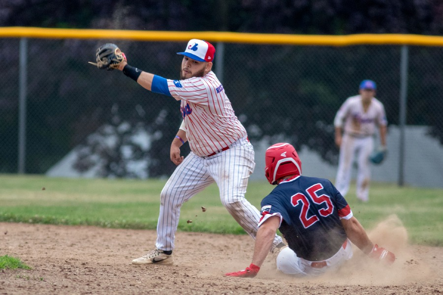 Record-Journal Expo's second baseman Hector Gonzalez could not tag out Rainbow Graphics Eric Brainard as he stole second base during a Greater Hartford Twilight Baseball League Game at Ceppa Field on Tuesday, July 7, 2020. Aaron Flaum, Record-Journal