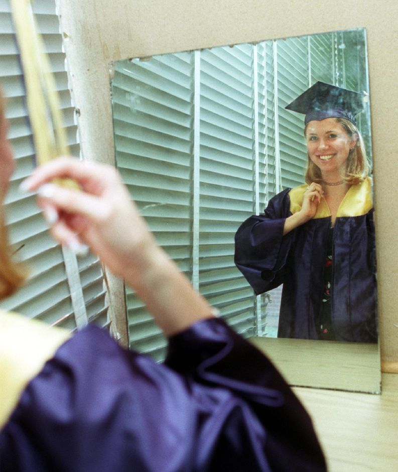 Platt senior Sarah Marie Hollman checks out her mortar board in a mirror in one of the classrooms before the start of graduation at Platt Thurs., June 15, 2000.