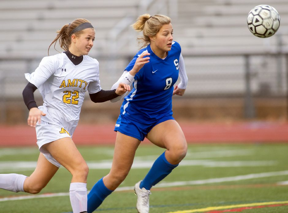 Allison Carr out-races Amity's Jenna Ciola for possession during the second round of the 2019 Class LL state tournament. Carr scored 16 of the 58 goals Southington piled up en route to the Class LL state championship game. Carr, a junior, was named All-State Class LL. Aaron Flaum, Record-Journal