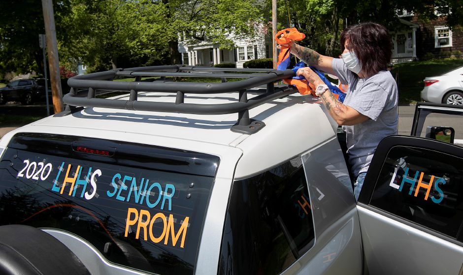 Lyman Hall High School reading teacher Sue Duda decorates her vehicle for the upcoming virtual senior prom, Fri., May 15, 2020. Prom season is still on for local high school seniors, with students and staff planning virtual celebrations. Dave Zajac, Record-Journal