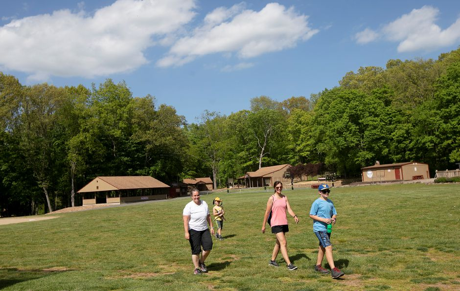 Jennifer Paventi, of Berlin, left, walks with friend Cheryl Grezlik, of Southington, and her two children Joshua Grezlik, 7, and Noah Grezlik, 12, while hiking around Camp Sloper in Southington, Fri., May 22, 2020. Camp Sloper will operate their on site programs this summer, though with strict guidelines in order to keep their staff and campers healthy and safe. Dave Zajac, Record-Journal