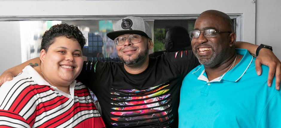 Hilbert Gibbs, right, owner of J&T Gifts and Novelty, smiles with children Tina Rivera, left, and Junior Salgado at the new 16A Center St. business in Wallingford, Tues., Jul. 7, 2020. Dave Zajac, Record-Journal