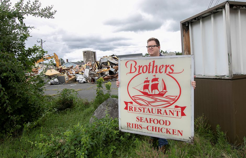 Bob Beaumont, of Wallingford, takes home the Brothers Restaurant sign as a piece of memorabilia during demolition of the former business on North Cherry Street in Wallingford, Tues., July 23, 2019. Dave Zajac, Record-Journal