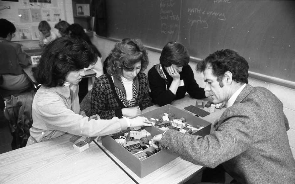 RJ file photo - Teachers Maureen DeLucia and Nancy Stabell of Parker Farms School, Barbara Dwyer of Chester and Ellington School Principal Frank Milbury work with LEGO toys as part of a two-day seminar on early childhood education held at Choate and sponsored by the State Department of Education and the Connecticut Institute of Teaching and Learning, March 1989.