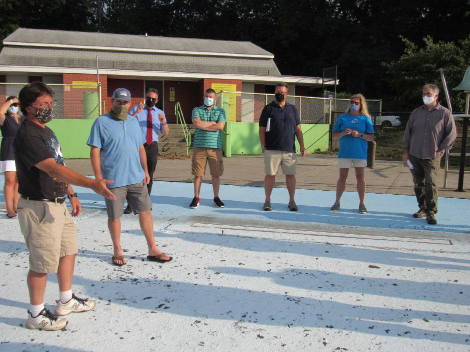 Members of the Town Council and  Parks and Recreation Department tour Community Pool on Wednesday.Lauren Takores, Record-Journal