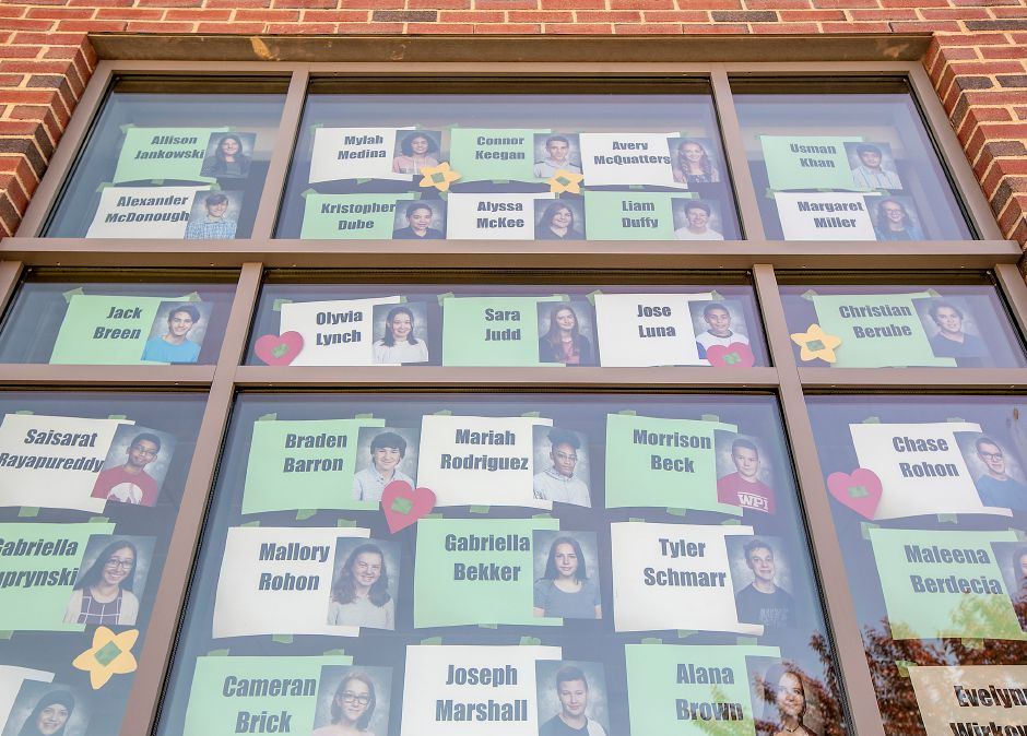 A tribute window for eighth-grade students at Kennedy Middle School in Southington, Thurs., May 21, 2020. The photos and names of more than 250 eighth graders, who are moving onto high school, now adorn the school