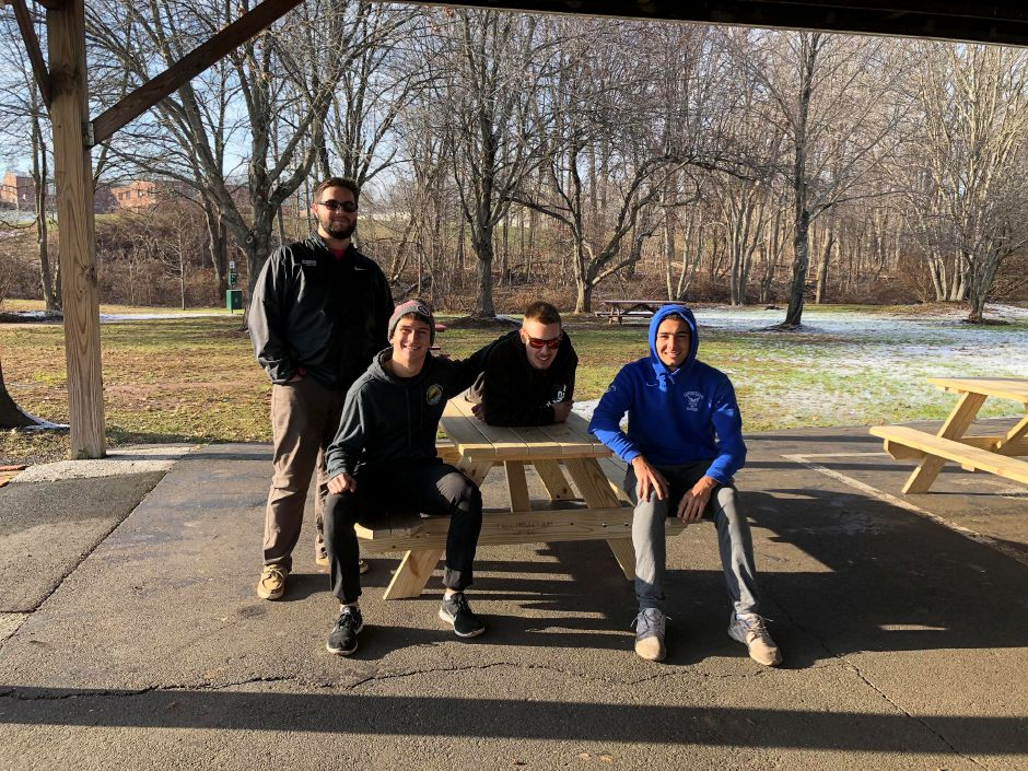 From left to right: Spencer Wondolowski, Nick Vestergaard, Erik Swanson and Evan Hempel pose by one of the picnic tables Vestergaard constructed for Allyn Brook Park as part of his Eagle Scout project. Photo courtesy of Nick Vestergaard.