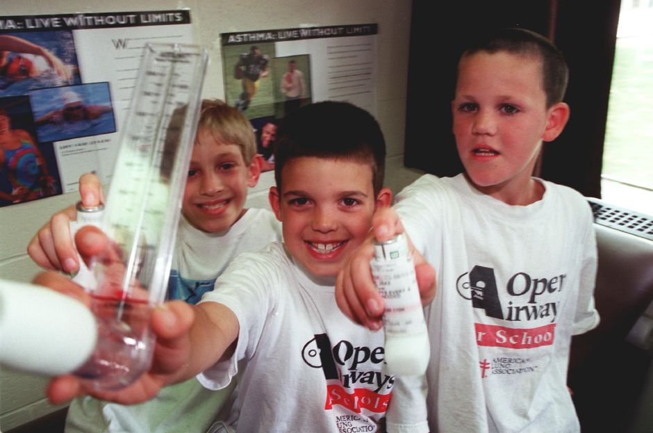 (L-R) Christopher Faust, 10, JP Figueiredo, 8, and Jake Condren, 9, participated in the first Open Airways program at William H. Hatton school in Southington June 8, 2000. The program taught the boys how to deal with and manage their asthma. Figueiredo (middle) is holding a Peak Flow Meter that measures a persons oxygen level to determine of it is necessary to relax, take medication or seek medical attention, the two other boys are holding inhalers that administer medication during an attack.