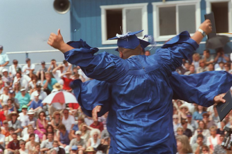 Upon receiving their diplomas Michael Cozzolino, front, and Christopher Crispine, take a leap of joy and collide in mid-air June 17, 2000.
