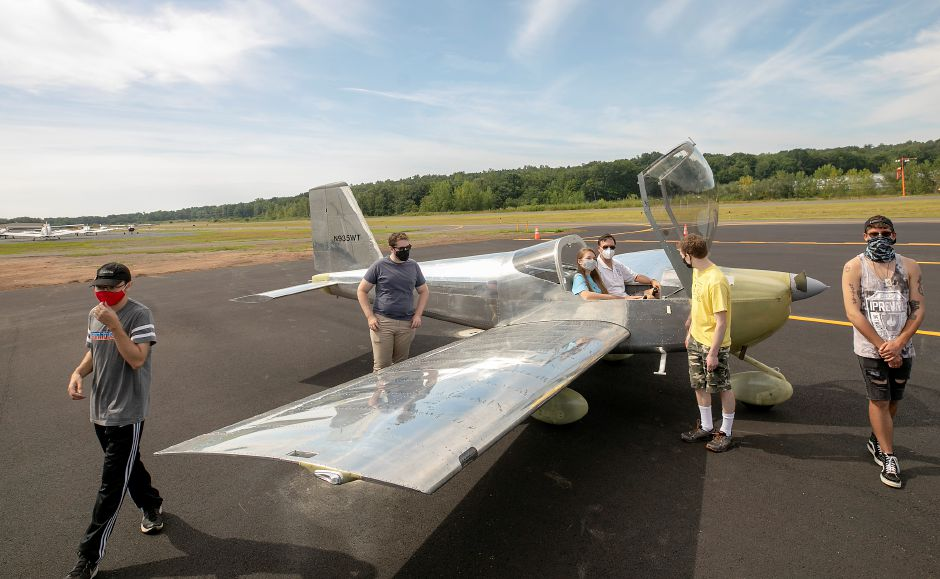 Pilot Mark Scott sits in an RV-12 plane built by Wilcox Technical High School students and members of the 'Teens to Flight' program at Meriden Markham Airport, Fri., Aug. 14, 2020. Left to right, Jaden Rogers, of Meriden, Tyler Stout, of Wethersfield, Kylie Johnson, of Middlefield, Kieran McGeary, of Meriden and Spencer Jenkins, of Meriden are some of the many plane