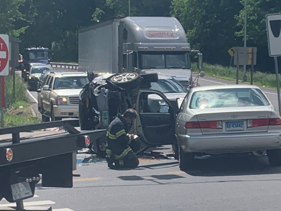 Emergency crews responded to a two vehicle crash with a rollover at the intersection of Camp and Broad streets in Meriden on June 1, 2020. | Bailey Wright/Record-Journal