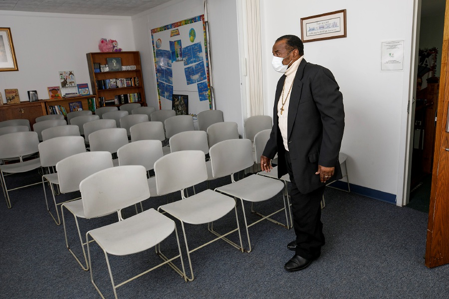 Pastor Willie Young walks through a worship room at Mount Hebron Baptist Church at 84 Franklin St., Meriden, on March 5.  A COVID-19 vaccination clinic was held at the church that month. The chairs pictured were  spaced out in accordance with COVID-19 guidelines for the clinic. Dave Zajac, Record-Journal