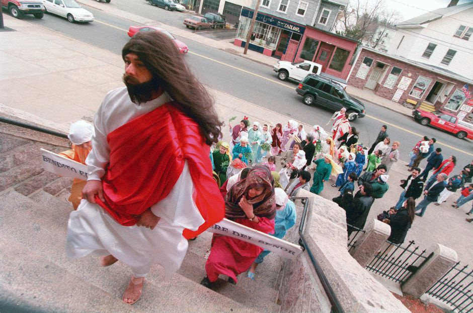 RJ file photo - Jesus Sandoval of Wallingford, portraying Jesus, leads his followers into Most Holy Trinity Church for Palm Sunday services March 28, 1999.