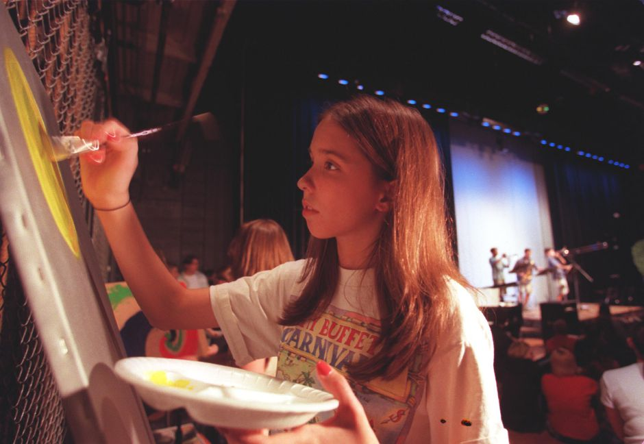 Rachel Prichette a senior at Southington High School works on her painting during the annual coffee house Thursday June 8, 2000.