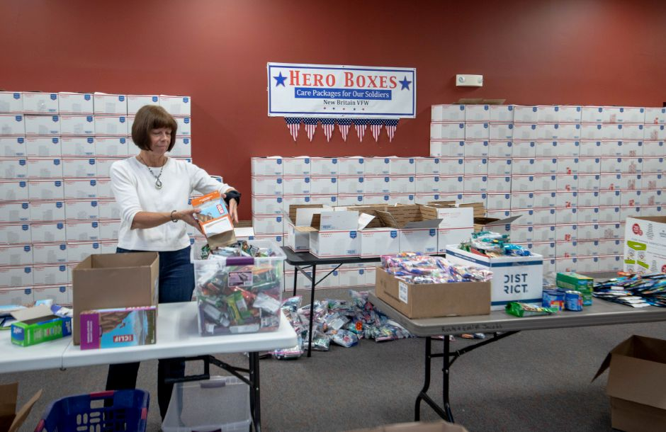 Barbara Banasiewicz helps sort energy bars for Hero Boxes, a Berlin-based nonprofit. It has moved its annual event filling up care packages with Christmas gifts for soldiers from Thanksgiving to Nov. 9, 2019. | Devin Leith-Yessian/Berlin Citizen