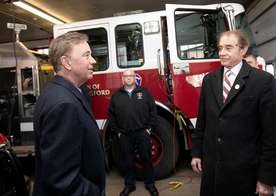 Gov. Ned Lamont, left, visits Wallingford Co. 1 on North Main Street with Mayor William W. Dickinson Jr. right, during a tour of the uptown area of Wallingford, Thurs., Feb. 28, 2019. At center is Shock Baitch, president of Wallingford Firefighters Association. Dave Zajac, Record-Journal