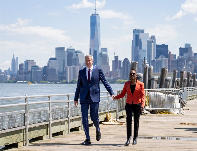 New York Mayor Bill de Blasio and his wife Chirlane McCray arrive for the official dedication ceremony of the Statue of Liberty Museum on Liberty Island Thursday, May 16, 2019, in New York. De Blasio announced Thursday that he will seek the Democratic nomination for president, adding his name to an already long list of candidates itching for a chance to take on Donald Trump. (AP Photo/Craig Ruttle)