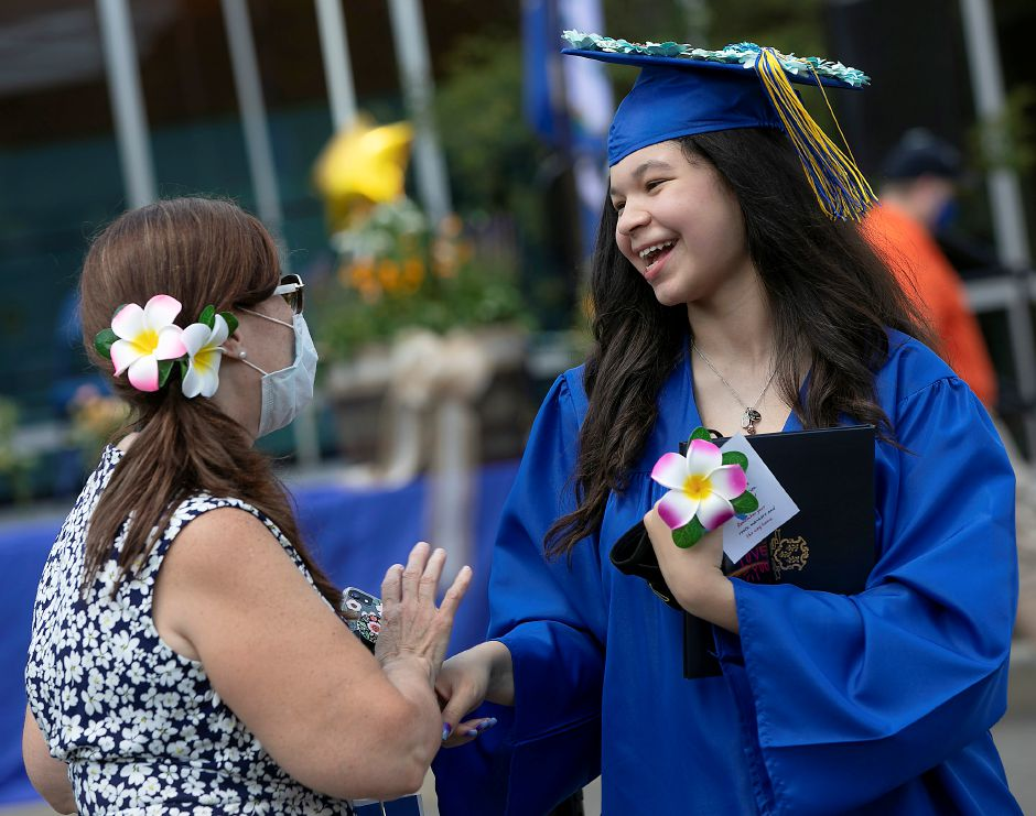 Hairdressing and cosmetology graduate Genesis Vazquez-Melendez  smiles with English language learners teacher Zayra Rivera after graduation ceremonies Monday at Wilcox Technical High School in Meriden. See grad list, more photos on A8.Dave Zajac, Record-Journal