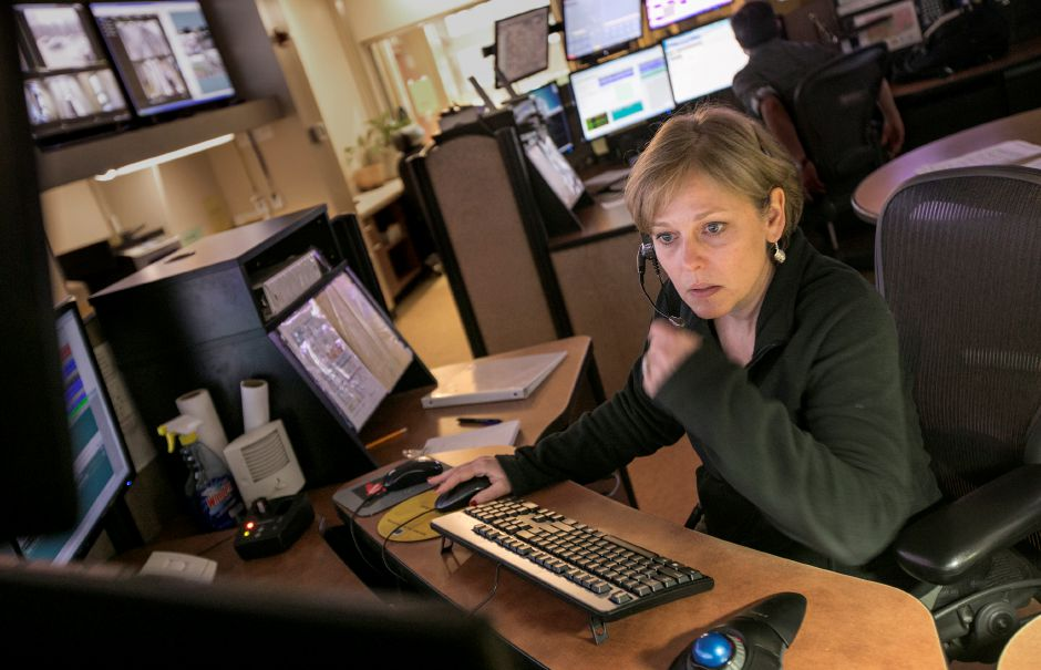 Dispatcher Wendy Roy, of Southington, works at her station at the Southington Police Department, Tuesday, April 10, 2018. Dave Zajac, Record-Journal