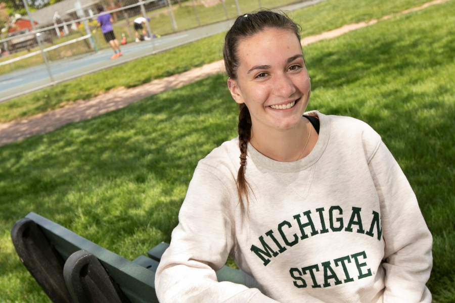 Sheehan High School student Gracie Waldron, 18, smiles on a break from playing tennis with friends at Doolittle Park in Wallingford, Tues., May 19, 2020. Waldron will be attending Michigan State University after the summer break. Dave Zajac, Record-Journal