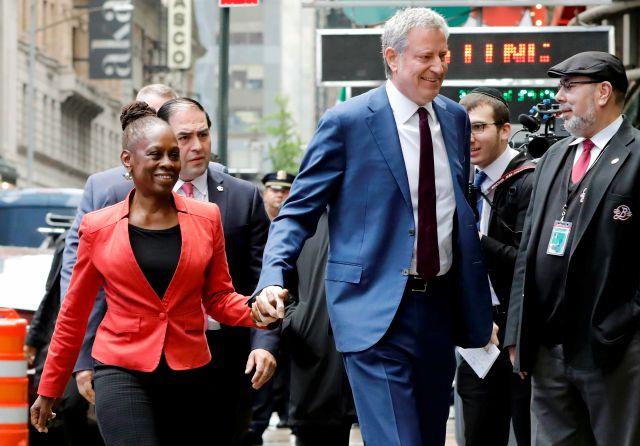 "New York Mayor Bill de Blasio and his wife Chirlane McCray arrive at ""Good Morning America"" in New York, Thursday, May 16, 2019. De Blasio announced Thursday that he will seek the Democratic nomination for president, adding his name to an already long list of candidates itching for a chance to take on Donald Trump. (AP Photo/Richard Drew)"
