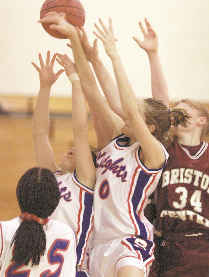 RJ file photo - Southington center Cathy Gombotz reaches for a rebound in a crowd of players Feb. 8, 1999.