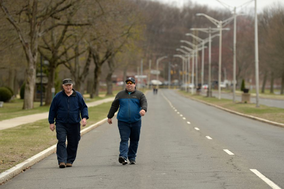 "Two men take a walk along a car-free Memorial Boulevard in Bristol on Tuesday, April 14, 2020. The city closed all city and school athletic fields and tracks, playgrounds and the skate park at Rockwell Park on April 1, due to the Covid-19 pandemic, but closed a quarter-mile stretch of the boulevard to car traffic ""in order to create additional passive recreation space,"" according to the town's website. 