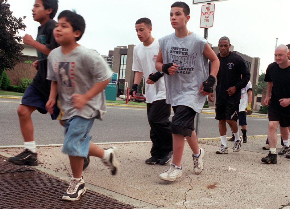 Members of the Silver City Boxing Club run along State Street Thursday evening June 15, 2000 as part of their training for Saturday night