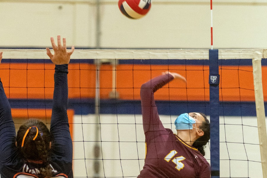Sheehan's Lydia Dellipoali gets the ball past Lyman Hall's Gianna Scopetto during a high school girls volleyball  game at Lyman Hall High School in Wallingford on Thursday. Sheehan won 25-21, 21-25, 25-22, 17-25 and 15-11.Photos by Aaron Flaum, Record-Journal