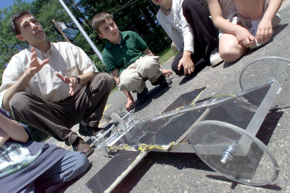 At William M. Strong School in Soutington, third grade teacher Nik Gernhard, left, demonstrates a class project with third grade student Richard Donovan next to him June 7, 2000. The class built a solar powered car during an energy unit in their science class.