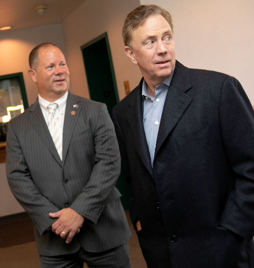 Gov. Ned Lamont, right, and Town Councilor Craig Fishbein visit the police station during a tour of Wallingford, Thurs., Feb. 28 2019. Dave Zajac, Record-Journal