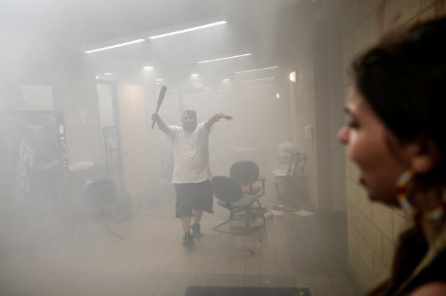 Protestors enter a burning Minneapolis 3rd Police Precinct, Thursday, May 28, 2020, in Minneapolis. Protests over the death of George Floyd, a black man who died in police custody Monday, broke out in Minneapolis for a third straight night. (AP Photo/John Minchillo)