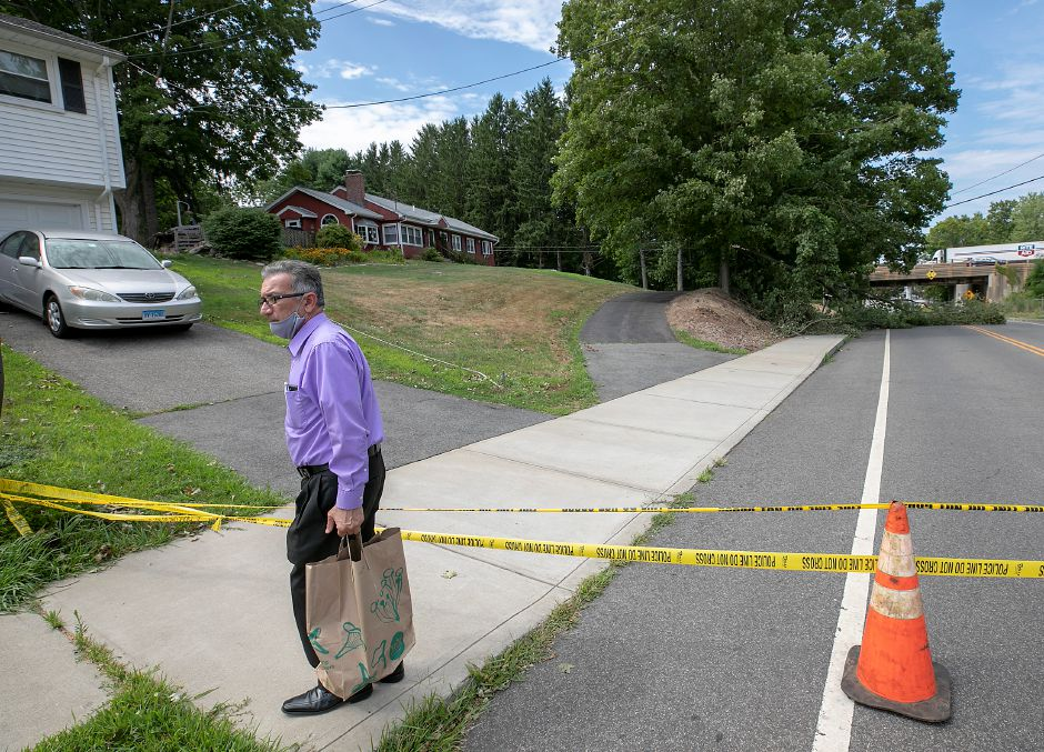 Police tape blocks the driveway of Nelson Irizarry